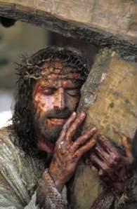 jesus-holding-cross[1]